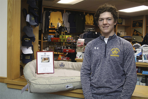 Griffin Moore '19 with his dog bed design at the School Store