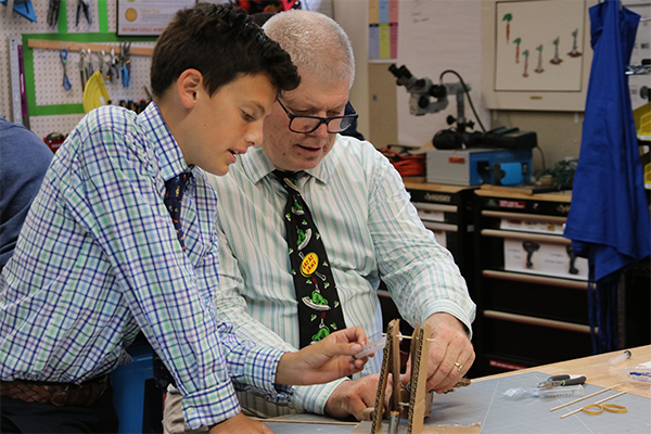 Bob Reilly working with students in the MakerSpace