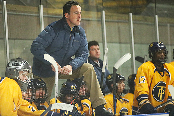 Trinity-Pawling Varsity Hockey Coach Robert Ferraris with the team
