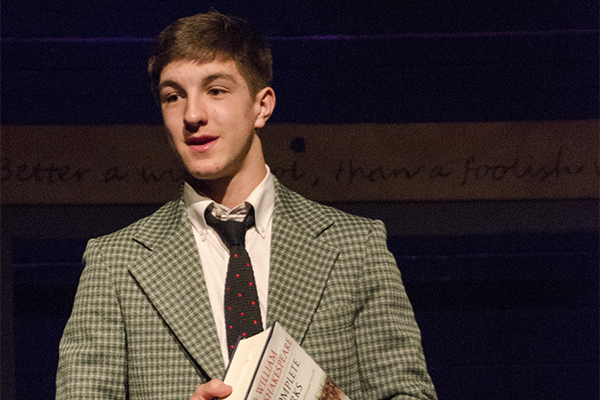 Trinity-Pawling student Soloman Hess on stage